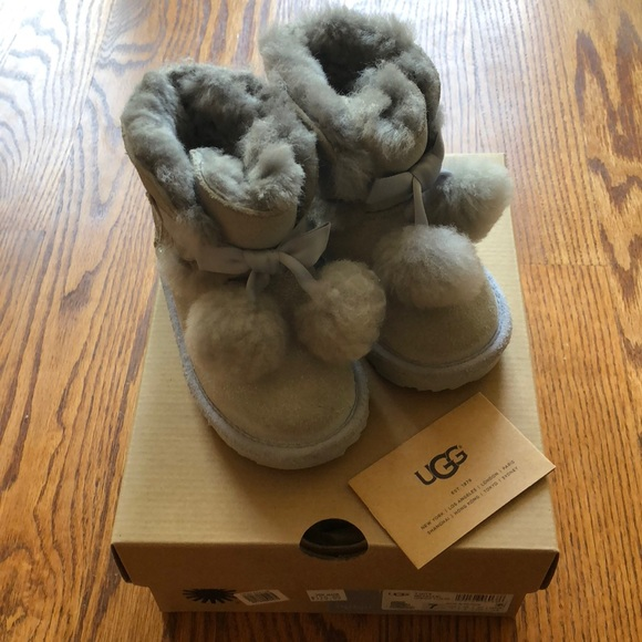 1abb363b0f6 UGG boots -toddler 7 silver with Pom pom bow